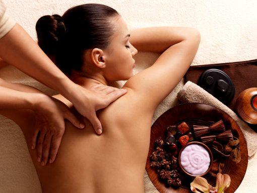 Woman having massage in the spa salon